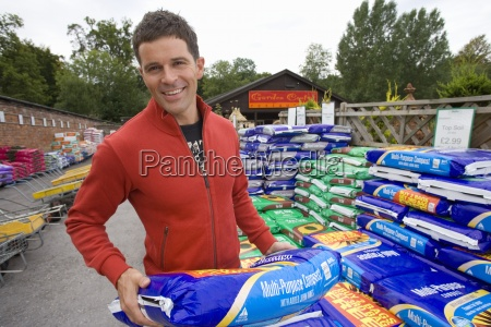 man with bag of soil in