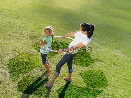 mother and daughter hula hooping on