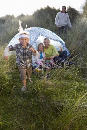 young family camping boy wearing indian