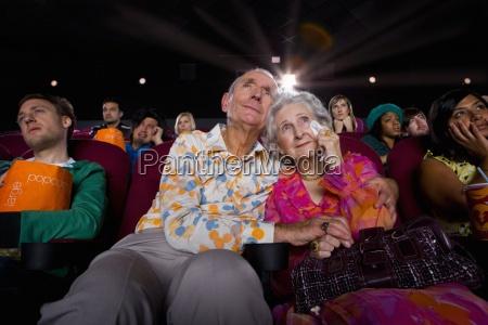 senior couple in cinema man with