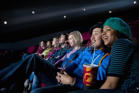 audience in cinema girl with drink