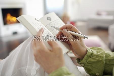 close up of woman playing sudoku