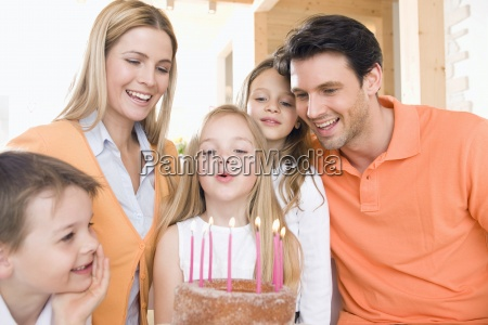 young girl with family holding birthday