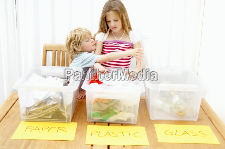 boy and girl separating paper plastic
