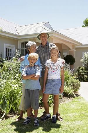 grandparents standing with grandchildren 6 11