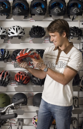man shopping for new cycling helmet