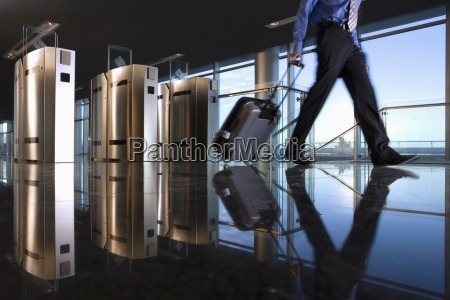 man with luggage walking away from