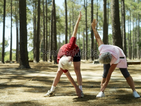 active senior couple in sportswear exercising