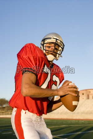 american football quarterback in red strip