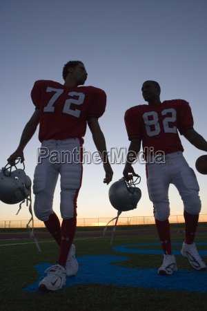 two american football players leaving pitch