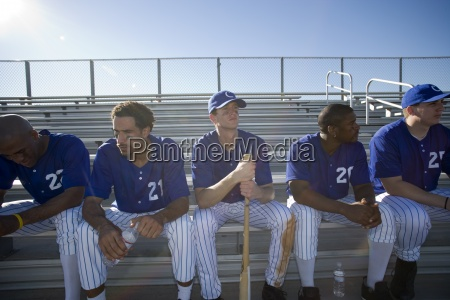 baseball team in blue uniform sitting