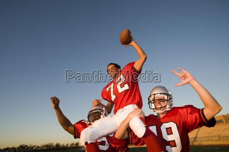 american football players in red football