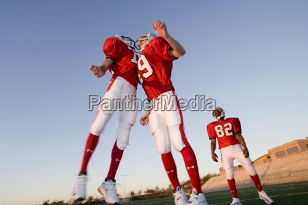 two american football players in red
