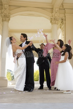 bride and groom embracing at wedding
