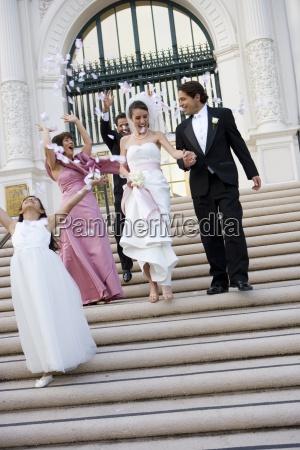 bride and groom descending steps outside