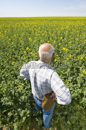 farmer standing with hands on hips