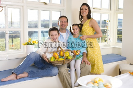 family with bowl of wooden easter
