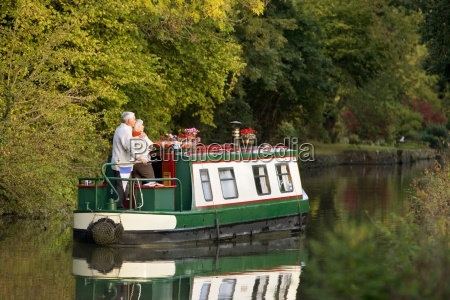 couple hugging on narrow boat in