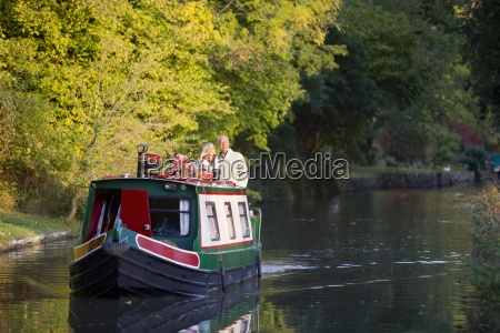 couple on narrow boat in canal