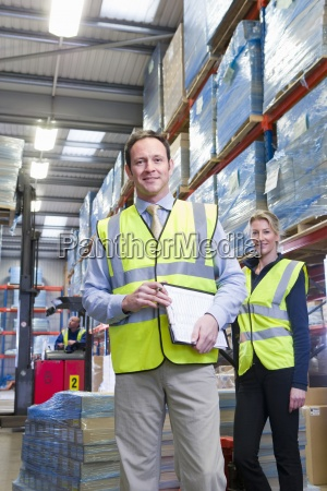 portrait of smiling warehouse manager and