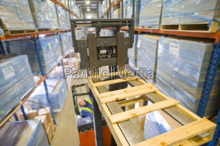 warehouse worker operating forklift