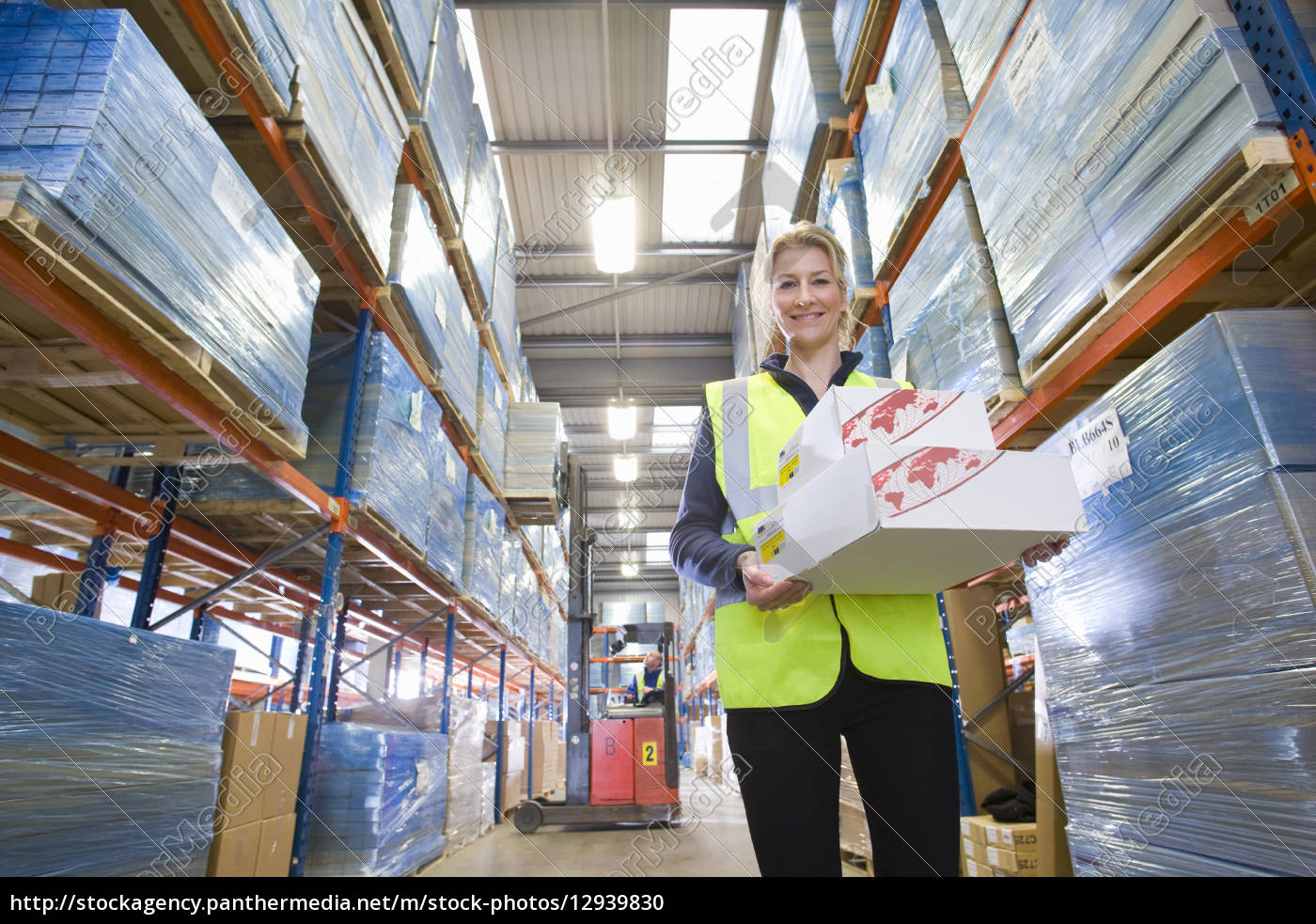 portrait, of, smiling, warehouse, worker, holding - 12939830