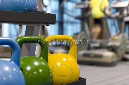 colorful medicine balls on rack in