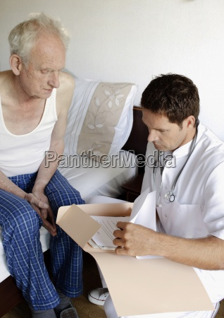 a doctor looking at the medical