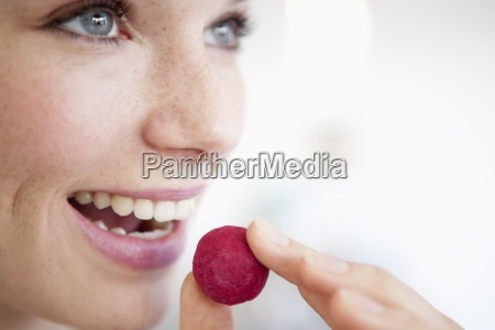 a woman eating a fruit flavored