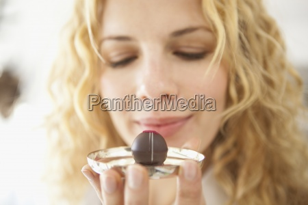 a woman holding at a chocolate