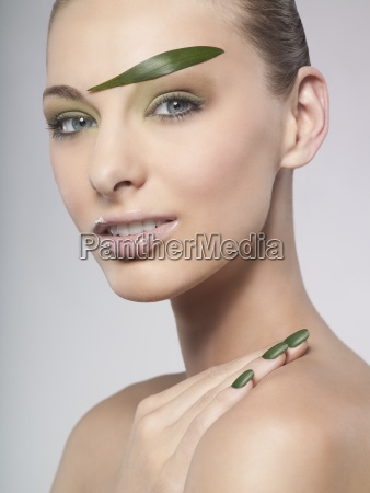 a woman wearing green nail polish