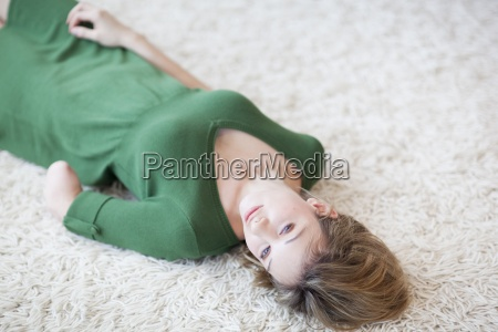young woman with amputee arm lying