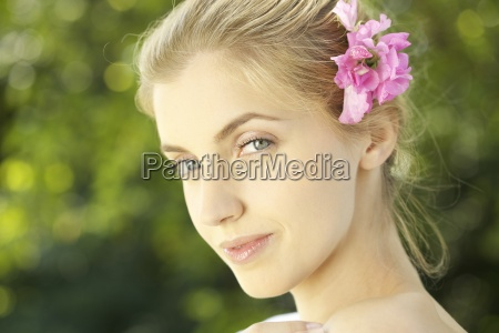 portrait of young woman with pink