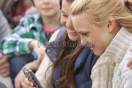 teenage girls viewing text message on