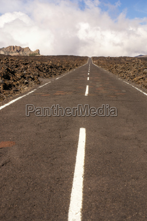 straight road with teide in the