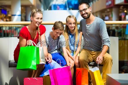 family with children shopping in a