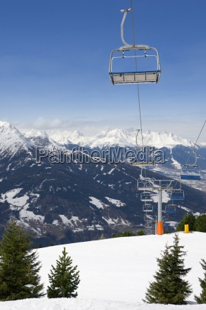 empty chair lift over remote mountainside
