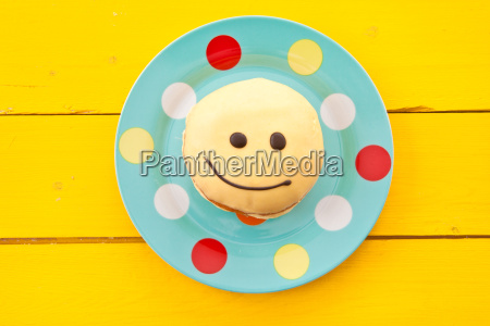 donut with smiley face