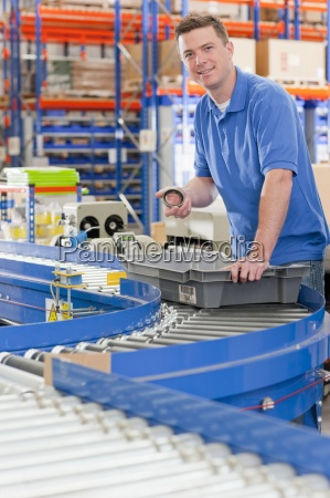 portrait of smiling worker with bin