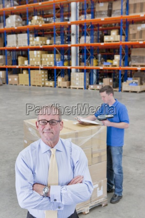 portrait of confident supervisor with worker