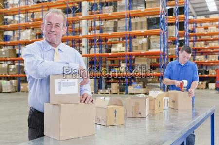 portrait of smiling supervisor leaning on