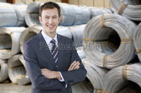 portrait of smiling businessman in front