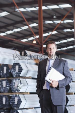 portrait of confident businessman with paperwork