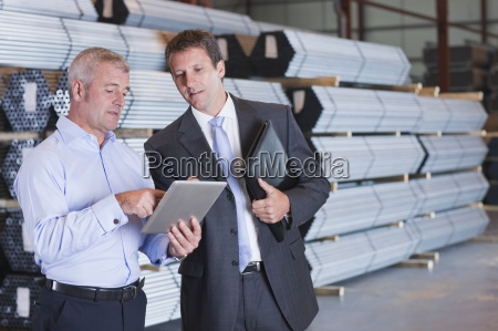 bank manager and business owner using