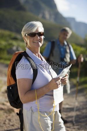 mature couple with rucksacks hiking on