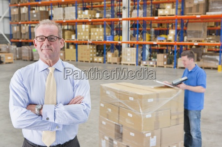 portrait, of, confident, supervisor, with, worker - 12958732