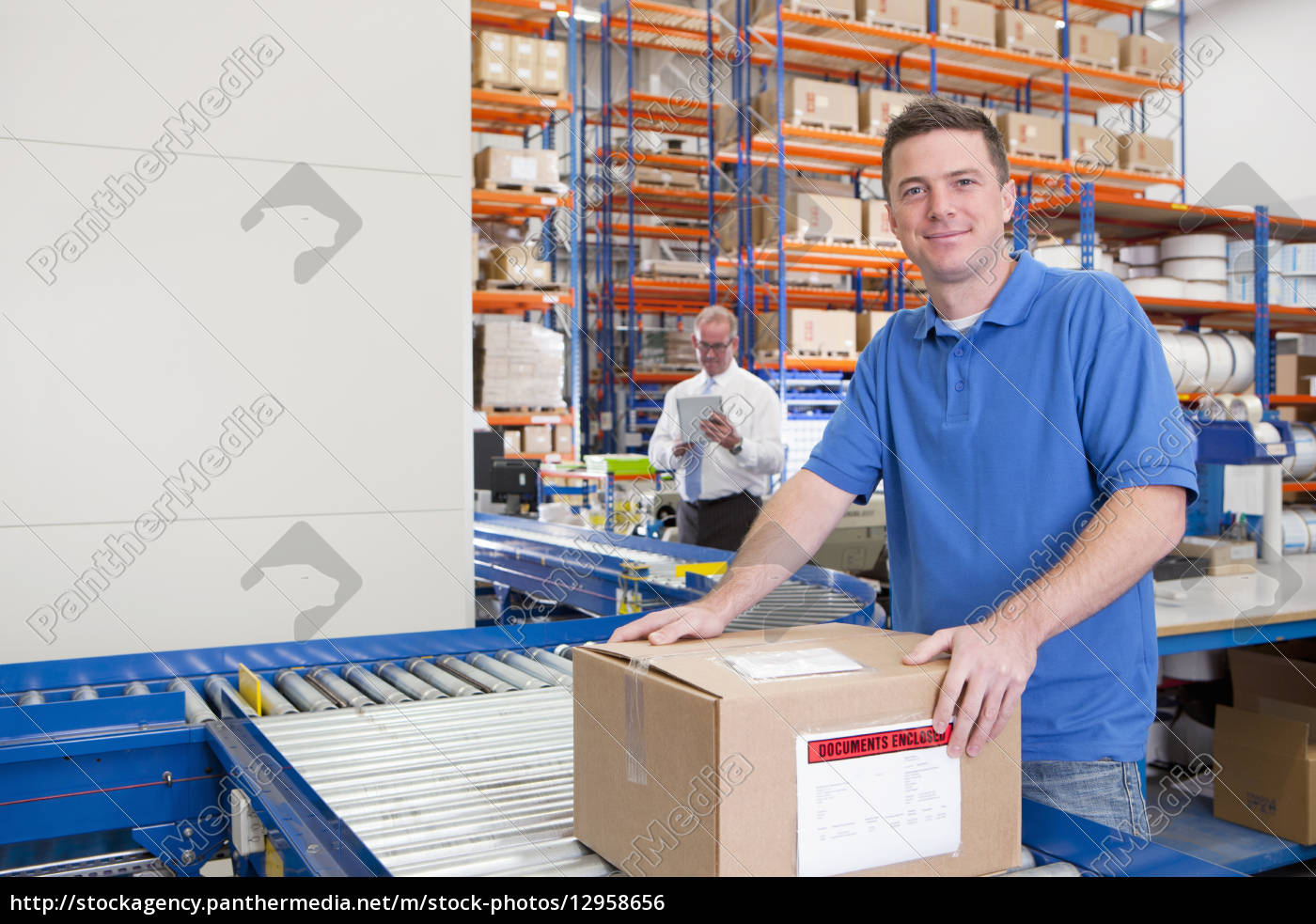 portrait, of, smiling, worker, with, cardboard - 12958656