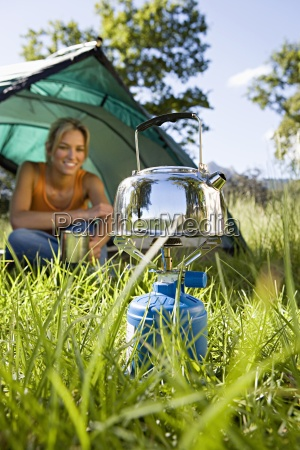 young woman sitting inside dome tent
