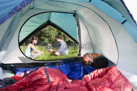 tent interior view of couple sitting