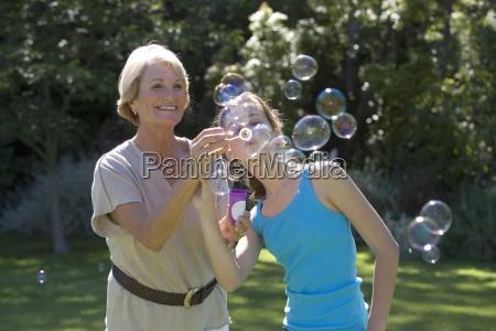 senior woman and granddaughter 11 13